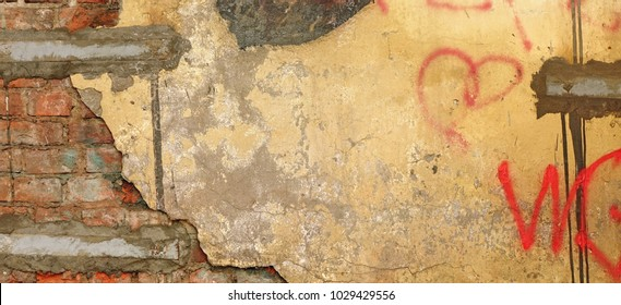 Vintage Brown White Yellow Distressed Brick Wall With Graffiti Urban Street Art Rough Wide Texture Or Grunge Background. Worn Concrete Wall With Painted Lines And Drawing. Grungy Grafitti Web Banner.