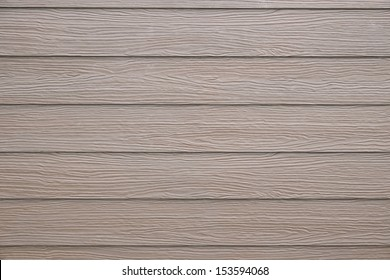 Vintage brown wood texture background of a house wall