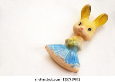 Vintage bunny toy on white background.