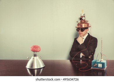 Vintage businessman with alert light sitting at office desk