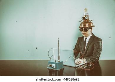 Vintage businessman sitting at office desk