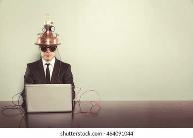Vintage businessman sitting at office desk