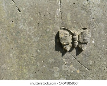 vintage butterfly relief carved in stone as a religious symbol for the human soul