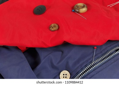 Vintage buttons and pins on synthetic fabric close up