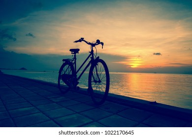 Vintage Bycicle on the beach at sunset.