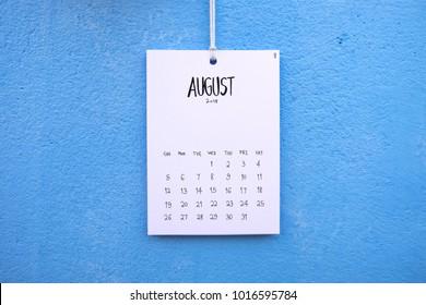 Vintage calendar 2018 handmade hang on the blue wall, August 2018