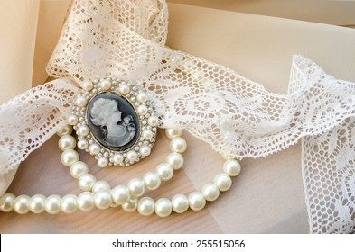 vintage cameo, pearls and lace