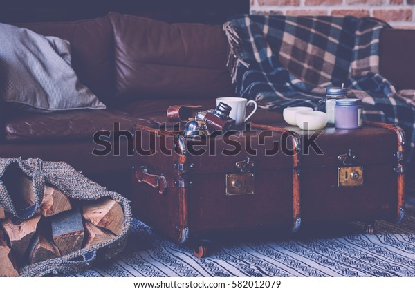 Vintage camera and cup of coffee on old vintage suitcase.