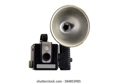vintage camera with flash unit isolated on white