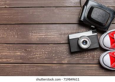 Vintage camera and gumshoes
