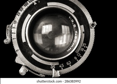 Vintage camera lens close-up isolated on black