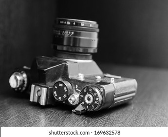 Vintage camera lying on a dusty closet shelf