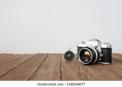 Vintage camera Mock up on wooden background