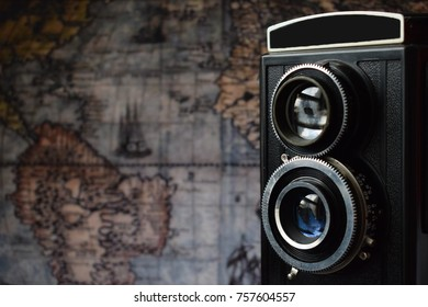 vintage camera with the old world map in the background