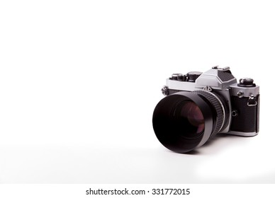 Vintage camera on isolated white background.