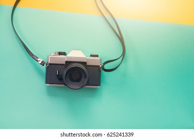 Vintage camera on vintage pastel background.