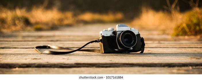 Vintage Camera on a wood path