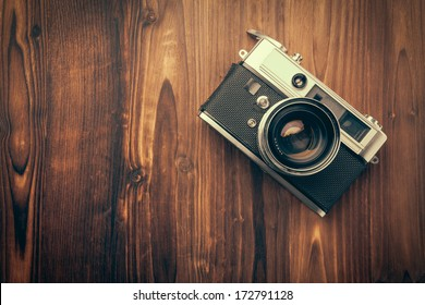 Vintage camera on wooden background - Shutterstock ID 172791128
