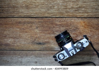 Vintage camera on wooden background and copy space