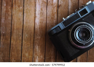 Vintage camera on wooden table.