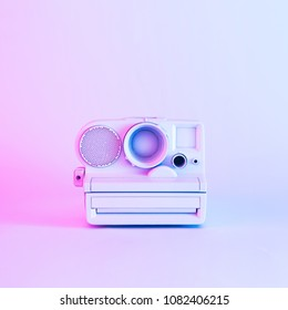 Vintage camera painted in white with vibrant bold gradient purple and blue holographic color lights. Concept art. Minimal summer surrealism.