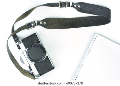Vintage Camera With Strap And Book On White Background Top View