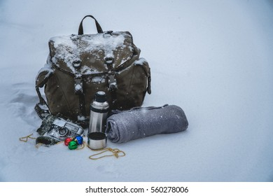 vintage camera winter backpack Plaid gloves Snow tea coffee thermos