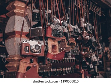 vintage cameras at flea market. Collection of retro-film analog cameras. many kinds of different model old photo cameras in a street store.