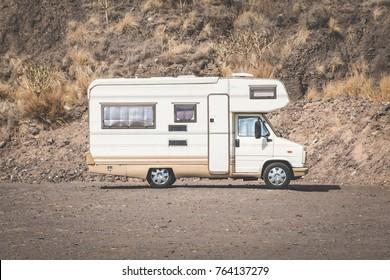 vintage camping bus, rv camper in desert landscape,