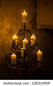Vintage candlestick with candles in the dark room. Romantic atmosphere of the old house.