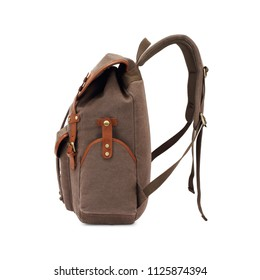 Vintage Canvas Backpack Isolated on White Background. Side View of Satchel Rucksack with Zippered Compartment. Travel Camping Daypack. Brown School Bag with Shoulder Straps and Haul Loop at the Top