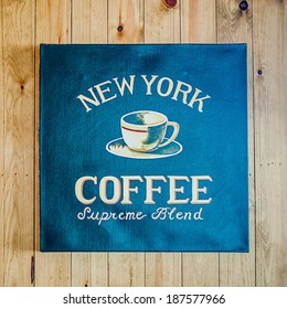 Vintage canvas sign - New York Coffee on wooden wall