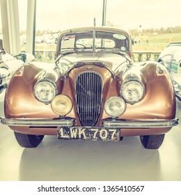 Vintage car from the 1950's. Jaguar Daimler Heritage Trust Collections Centre British Motor Museum, Gaydon, Warwickshire / UK - January 12 2019: 1952 Jaguar XK120 front view.