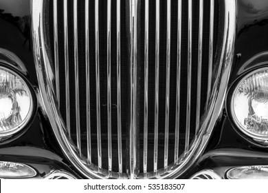 Vintage car detail with black color - chrome grille
