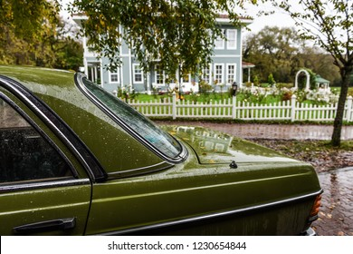 Vintage car in front of house