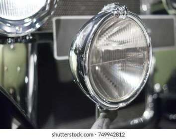 Vintage car headlight close up.