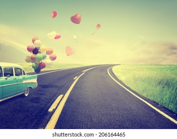 Vintage Car with heart balloon concept of love in summer and wedding honeymoon