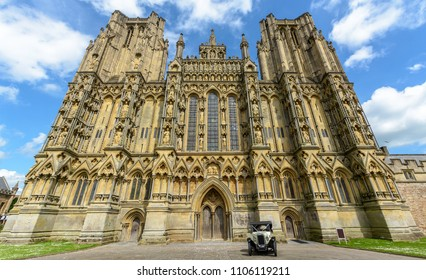 Vintage Car parked in front of Wells Cathedral, mid view horizontal photography