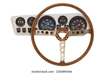 Vintage car steering wheel and cockpit with meters isolated on a white background
