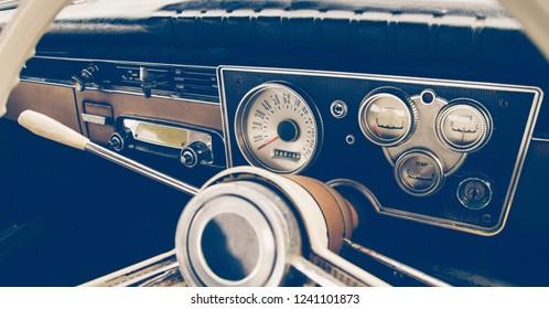 Vintage car steering wheel and dashboard