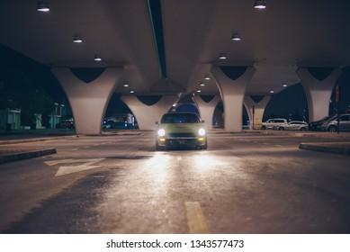Vintage car under the Al Safa Bridge parking lot in Dubai. August 2018