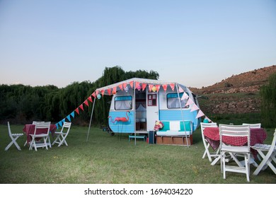 Vintage caravan set up for wedding outside