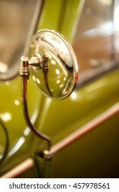Vintage car,Chrome rear view mirror,blur and selective focus