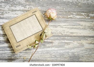 Vintage cardboard photo frame and dried rose