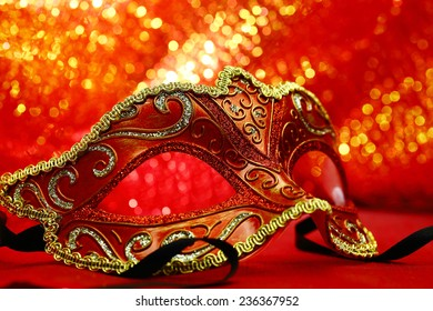 Vintage carnival mask in front of glowing background