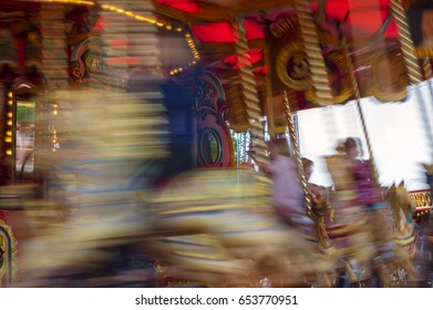 Vintage Carousel in gold and red blurred of motion