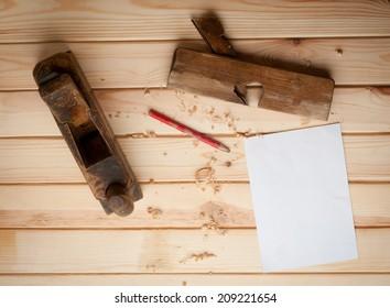 Vintage carpenter tools in pine wood table