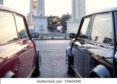 Vintage cars Morris Cooper parked on the road in the sunset
