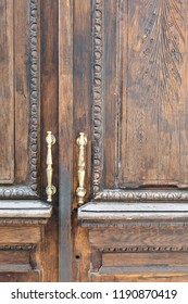 Vintage carved wooden door with metal handle