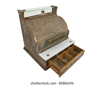 Vintage cash register and 1930's coins with money drawer open.